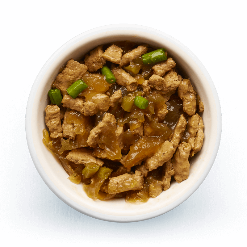 An image of Tails wet food. Steamed fillets with lamb, chicken & green beans in tasty jelly.