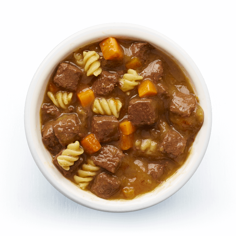 An image of Tails wet food. Hearty casserole with beef, pasta & carrots in tasty gravy.