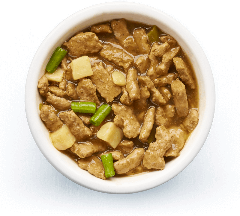 An image of Tails wet food. Country casserole with chicken, potato & green beans in tasty gravy.