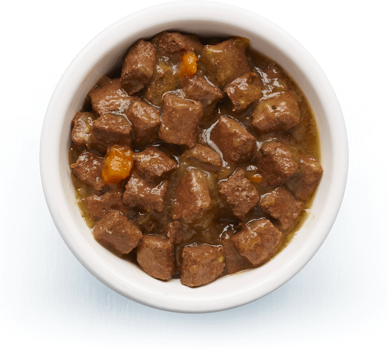 An image of Tails wet food. Shepherd's hotpot with lamb, vegetables & rosemary in tasty gravy.