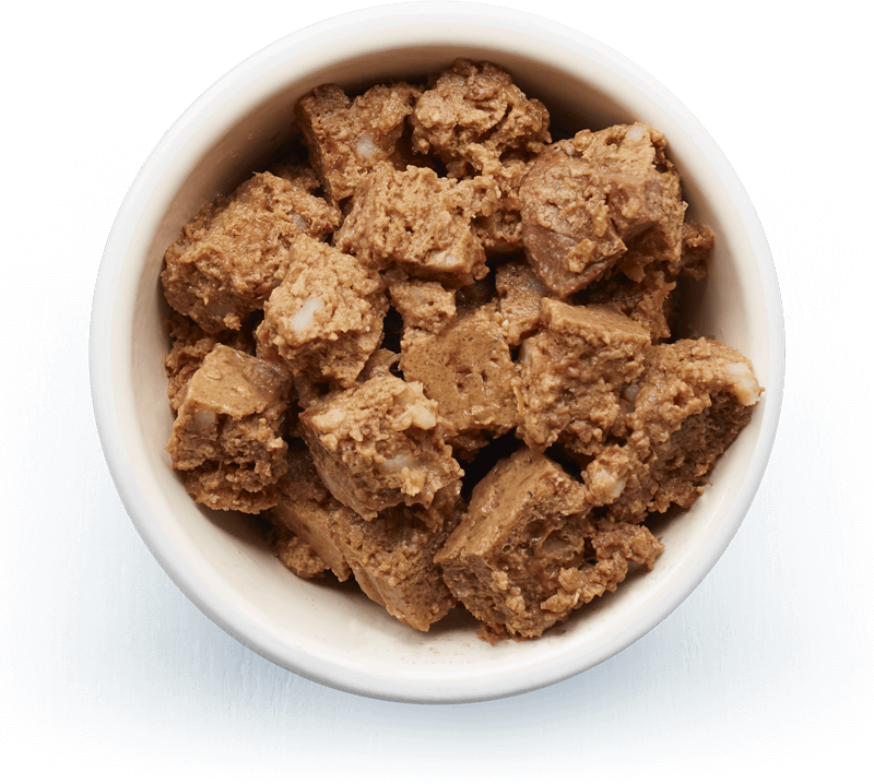 An image of Tails wet food. Tender pâté with chicken and rice.